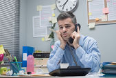 Tired businessman on the phone — Stock Photo