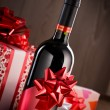 Chistmas gifts and wine bottle — Stock Photo #56131539