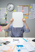 Office worker with blank sign — Stock Photo