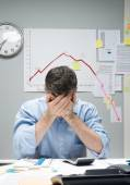 Desperate businessman with negative business chart — Stock Photo