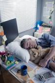 Funny office worker sleeping in the office overnight — Stock Photo