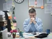 Pensive businessman at desk — Foto Stock