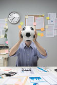 Soccer fan at workplace — Stok fotoğraf