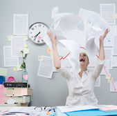 Angry businesswoman throwing paperwork in air — Foto Stock
