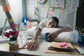 Tired businesswoman waking up in office — Stock Photo