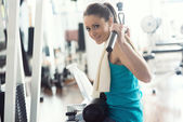Attractive woman exercising at gym — Foto de Stock