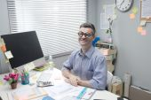 Nerd businessman at work — Stock Photo