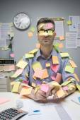Office worker covered with stick notes — Stock Photo