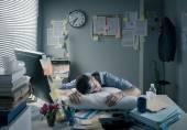Businessman sleeping in the office overnight — Stock Photo