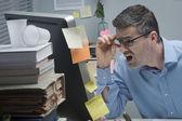 Businessman reading shocking news online — Stock Photo