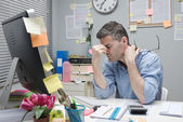 Depressed office worker at his desk — Stock Photo