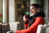 Woman relaxing at the cafe — Stock Photo