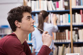Student studying at the library — Stock Photo
