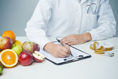 Female nutritionist at work — Stock Photo