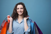 Cheerful young woman shopping — Stock Photo