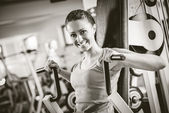 Attractive woman exercising at gym — Stock Photo