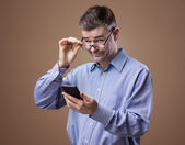 Man adjusting his glasses — Foto de Stock