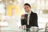 Smiling businesswoman with laptop — Stock Photo