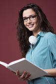 Beautiful student girl posing with notebooks — Stock Photo