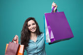 Cute young woman shopping — Stock Photo