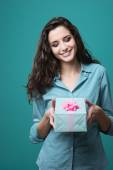 Girl giving a beautiful gift — Stock Photo