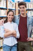 Teen students at the library — Stock Photo