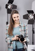 Photographer posing in a professional studio — ストック写真