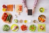 Online cooking app with kitchen worktop — Stock Photo
