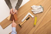 Customer choosing a wooden baseboard — Stock Photo