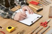 Man sketching a DIY project on paper — Stock Photo