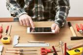 Craftsman working on a DIY project with his tablet — Stock Photo