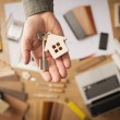 Real estate agent with house key — Stock Photo #71737423