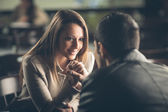 Romantic couple flirting at the bar — 图库照片