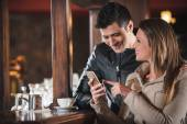 Young couple at the bar — Stock Photo