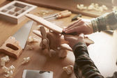 Craftsman building a wooden toy airplane — ストック写真