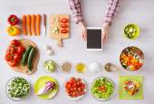 Online cooking app with kitchen worktop — Stock Photo