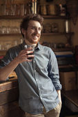 Hipster man drinking a glass of coke — Stock Photo