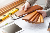 Interior designer choosing a baseboard — Stock Photo
