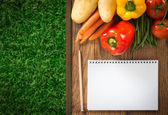 Farmer's notebook with vegetables — Stockfoto