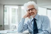 Confident businessman posing at the office — Stock Photo