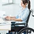 Young disabled businesswoman at work — Stock Photo #78289944