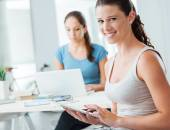Girls using new technologies at home — Stock Photo