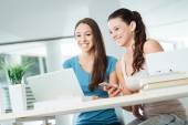 Cheerful girls social networking — Stock Photo
