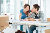 Couple designing their new house — Stock Photo