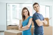 Loving couple posing in their new house — Stock Photo