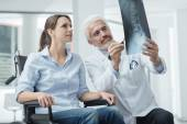 Doctor examining a patient x-ray — Stock Photo
