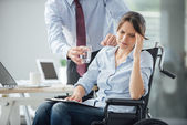Disabled business woman with headache — Stock Photo