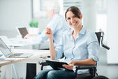 Happy office worker in wheelchair — Stock Photo