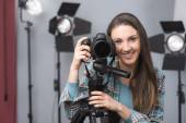 Young photographer posing — Stock Photo