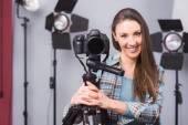 Young photographer posing — Stock Photo